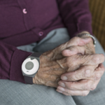 personal alarm on elderly hand_300small