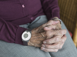 personal alarm on elderly woman's hand