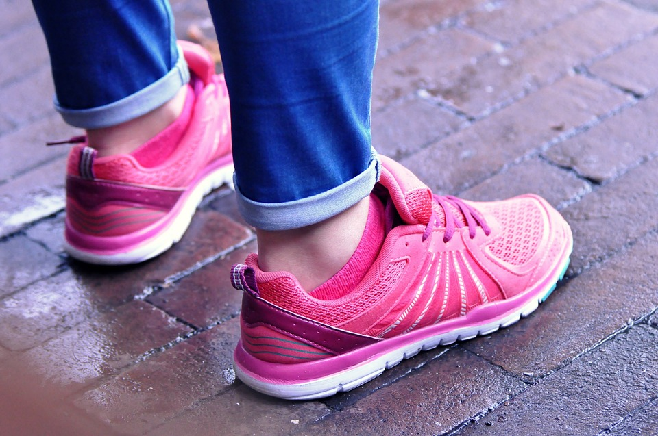 image of person standing with running shoes