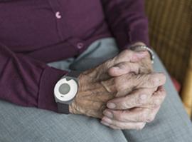 personal alarm on elderly hand_300small